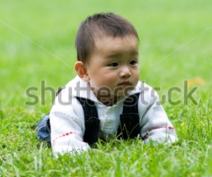 stock-photo-a-baby-lying-on-the-ground-29694109
