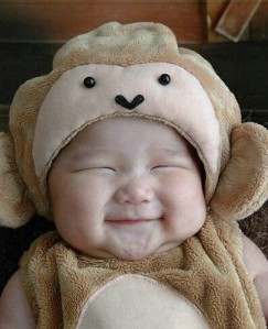 Cute smiling baby in teddy bear outfit